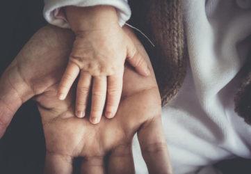 child hand in parent hand